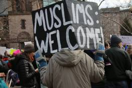 Protesters hold up signs at a Copley Square protest in Boston on January 22, 2017, in response to President Trump's Executive Order on immigration or travel from seven predominantly Muslim nations.