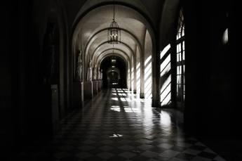 The Château de Versailles is opulent but some areas still retain a solemn aura.